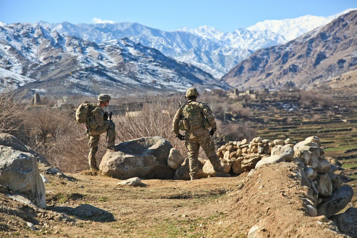 mountain view and two soldiers